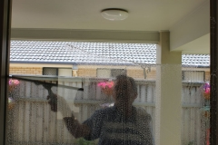 Hard at work window cleaning at Caloundra.